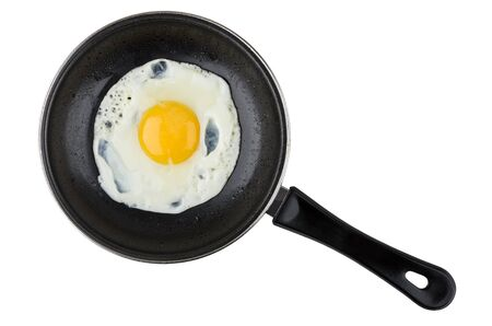 Eggs in small pan with plastic handle isolated on white background