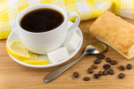 flaky: Black coffee, lemon and sugar, flaky biscuits on bamboo wooden table
