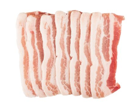 Pieces of raw bacon isolated on white background