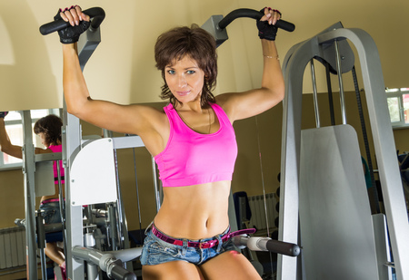 gym clothes: Portrait of young beautiful woman at gym