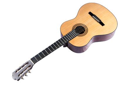 nylon string: Lying diagonally classical guitar isolated on white background