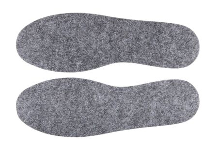 insoles: Pair of felt insoles isolated on white background