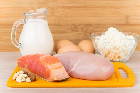 'breast milk': Products sources of protein and unsaturated fatty acids on wooden table