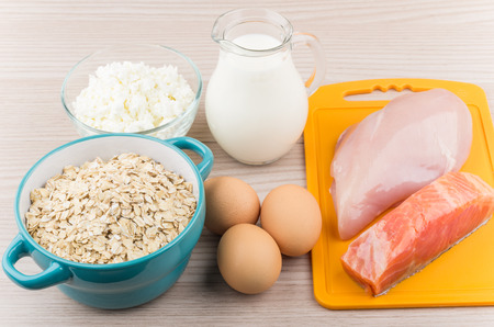 milk: Foods rich in protein and carbohydrates on wooden table