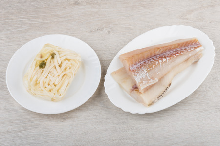 alaska pollock: Alaska Pollock fillets, jelly with squid in plate on table