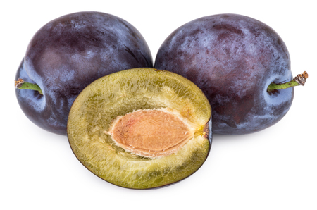 Two plums and one half plums with pits isolated on white background