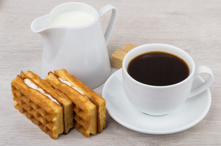 viennese: Black coffee with viennese waffles and jug milk on wooden table