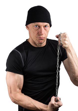Evil man in black with chain tight in his hands isolated on white background Stock Photo