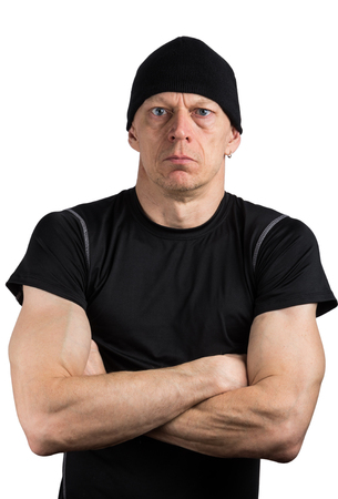 Muscular arrogant man in black isolated on white background