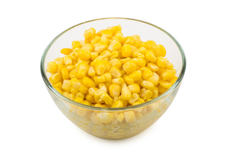 Canned sweet corn in glass bowl isolated on white background Stock Photo