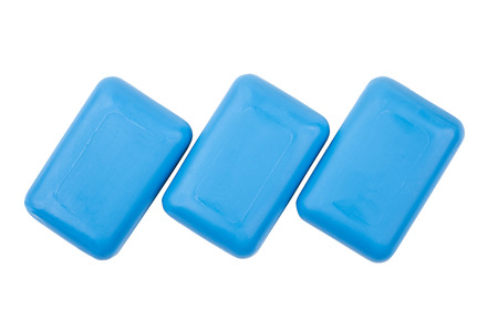 roundish: Three pieces of blue soap isolated on white background. Top view