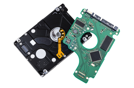 Hard drive with removed printed circuit board isolated on white background
