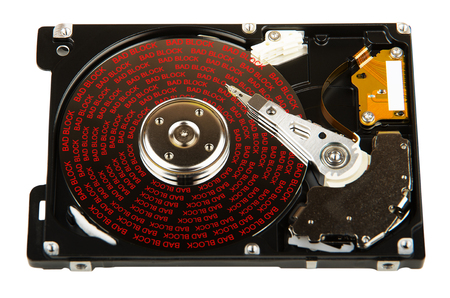 Faulty hard disk with bad blocks on surface isolated on white background
