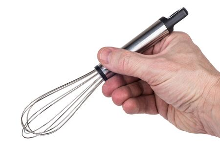 Whisk with shiny handle in male hand isolated on white background Stock Photo