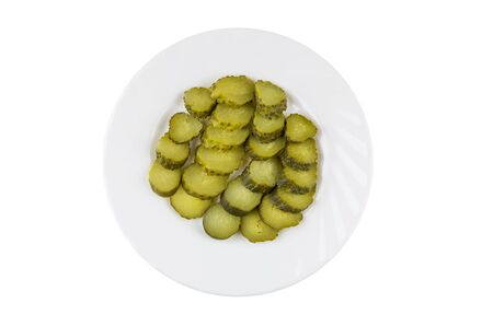 marinated gherkins: Slices of pickled gherkins in white plate isolated on white background. Top view Stock Photo