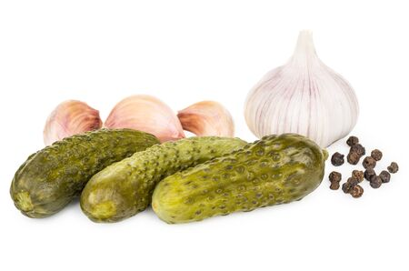 marinated gherkins: Heap of pickled gherkins, garlic and black pepper isolated on white background Stock Photo