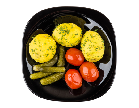 marinated gherkins: Baked potatoes with dill, pickled gherkins and tomatoes isolated on white background. Top view