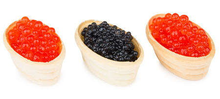 Tartlets with imitation red and black caviar isolated on white background