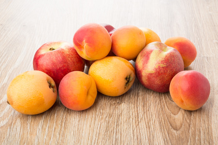 Heap of different ripe fruits on wooden table Stock Photo
