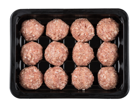 Plastic container with raw meatballs isolated on white background. Top view