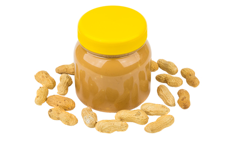 Transparent plastic jar with peanut butter and unpeeled peanuts isolated on white background Stock Photo