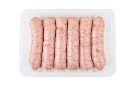Raw chicken sausages in plastic container isolated on white background. Top view