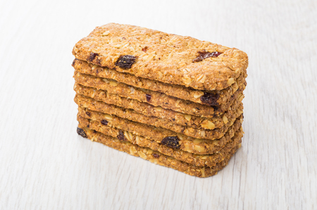 Stack of cookies-muesli with cranberries and raisin on wooden table
