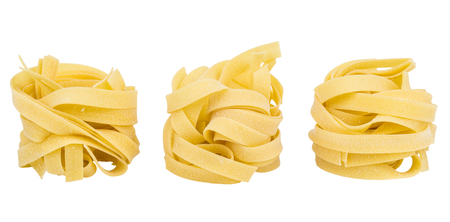 Row of pasta fettuccine isolated on white background