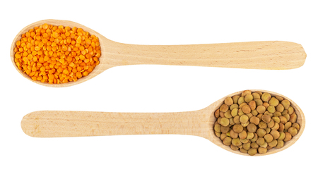 Red and green lentils in wooden spoons isolated on white background. Top view Reklamní fotografie