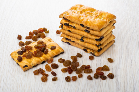 Stack of cookies with raisin, scattered raisin on cookie on wooden table Stock Photo