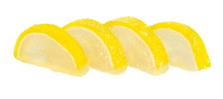 Few marmalade in form slices of lemon isolated on white background
