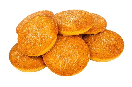 Heap of orange shortbread cookies isolated on white background