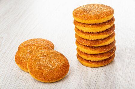 Stack of orange shortbread cookies, cookies on light wooden table