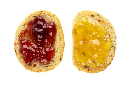Sandwiches with strawberry jam and lemon jam isolated on white background. Top view Imagens