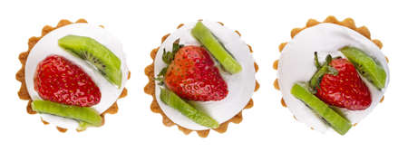 Three tartlets with cream, strawberry and kiwi isolated on white background. Top view