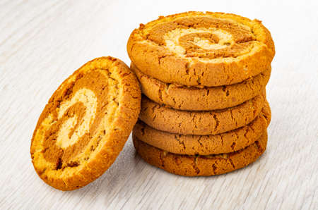 Stack of oat cookies on light wooden table Archivio Fotografico