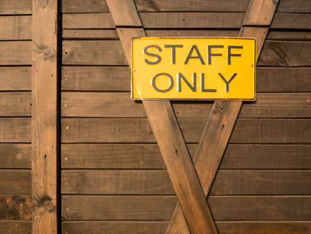 staff only: Staff only on real wooden background