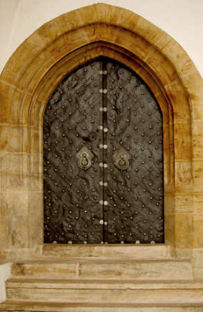 Iron gothic doors with ornaments frammed in the wall