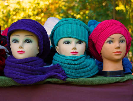 Three artifical womens heads with hats and make-up Stock Photo