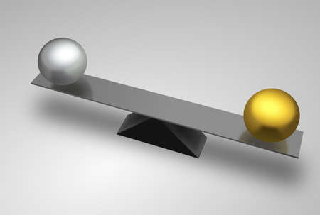 Metal seesaw with golden and silver balls