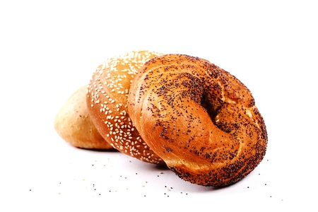 Isolated freshly baked rolls with poppy and sesame seeds Stock Photo