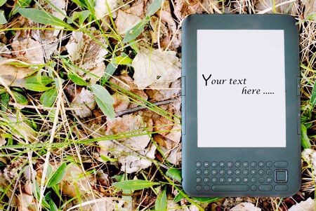 Modern ebook on lying on the dry leaves in forest