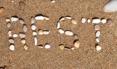 REST word on the sand beach Stock Photo - 15098536