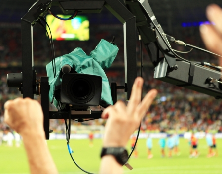 TV Camera shoots fans sector during Match