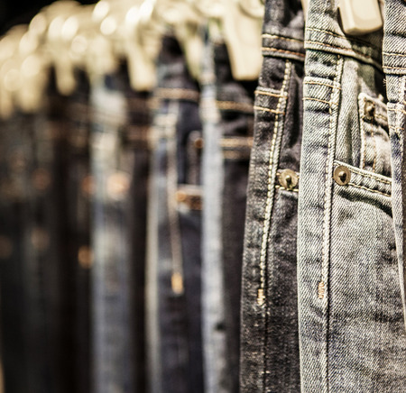 Garment rack with classic Jeans close up shot 스톡 콘텐츠