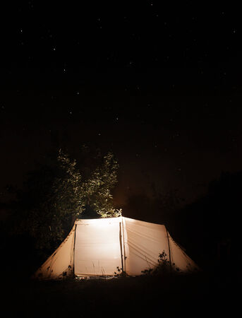 Night camping tent  on the dark sky star background   Ursa Major is visible Stock Photo