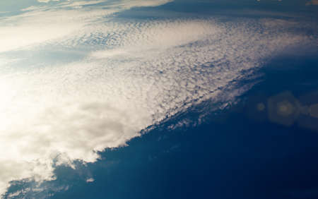 Beautiful white cirrus clouds on the deep blue sky Stock Photo