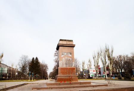 DNIPRODZERZHYNSK, UKRAINE  23 FEBRUARY 2014: Demonstrators destroyed the monument of Vladimir Lenin in the centre of Dniprodzerzhynsk during Ukrainian revolution on February 23,2014 in DNIPRODZERZHYNSK, UKRAINE