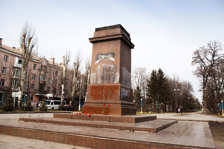 DNIPRODZERZHYNSK, UKRAINE  23 FEBRUARY 2014: Demonstrators destroyed the monument of Vladimir Lenin in the centre of Dniprodzerzhynsk during Ukrainian revolution on February 23,2014 in DNIPRODZERZHYNSK, UKRAINE