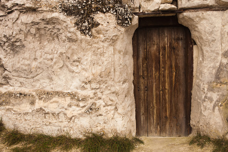 Old Wizard cave house entrance door Stock Photo